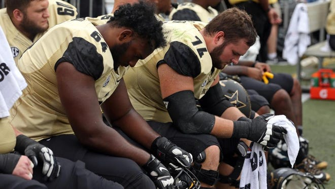 Vanderbilt guard Delando Crooks (64) and offensive lineman Will Holden (74) react on the sideline during the fourth quarter of the Commodores' loss at Georgia Tech on Saturday.