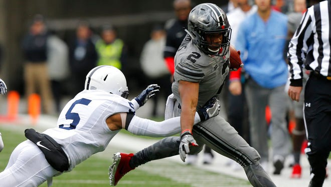 Penn State defensive back Tariq Castro-Fields, left, forces Ohio State running back J.K. Dobbins out of bounds during the first half of an NCAA college football game Saturday, Oct. 28, 2017, in Columbus, Ohio. (AP Photo/Jay LaPrete)