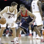 Cleveland Cavaliers' Matthew Dellavedova (8), from Australia, goes against Washington Wizards' Ramon Sessions (7) in an NBA basketball game Wednesday, April 15, 2015, in Cleveland.