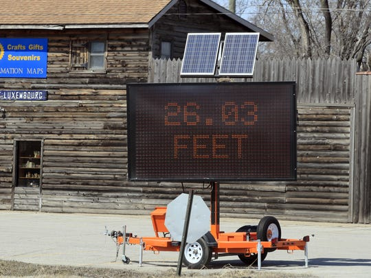Missouri River levels are posted near a souvenir shop in Elwood, Kan., Monday, March 18, 2019. Hundreds of homes flooded in several Midwestern states after rivers breached at least a dozen levees following heavy rain and snowmelt in the region, authorities said Monday while warning that the flooding was expected to linger.