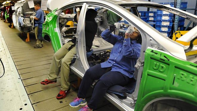 Hyundai team members assemble vehicles at Hyundai Motor Manufacturing Alabama in Montgomery on March 11, 2015.