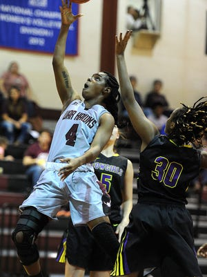 McMurry's Sham Hunter (4) lays in a shot past Hardin-Simmons' Kayla Brown (30) during the third quarter of the War Hawks' 63-58 win on Saturday, Feb. 11, 2017, at McMurry's Kimberly Arena.