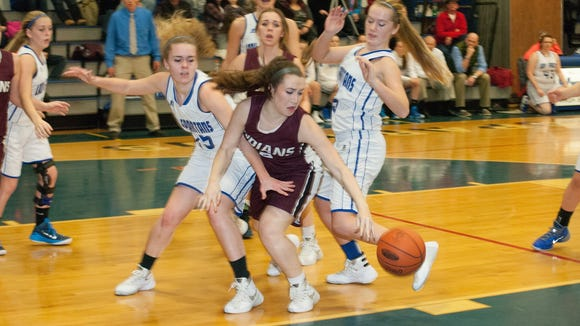 McConnellsburg's Bridgette Ritchey, left, and Southern Fulton's Shaye Smartt fight for a loose ball during a game in the regular season. The Indians and Spartans will meet again on Saturday at 2 p.m. in the District 5-A championship.