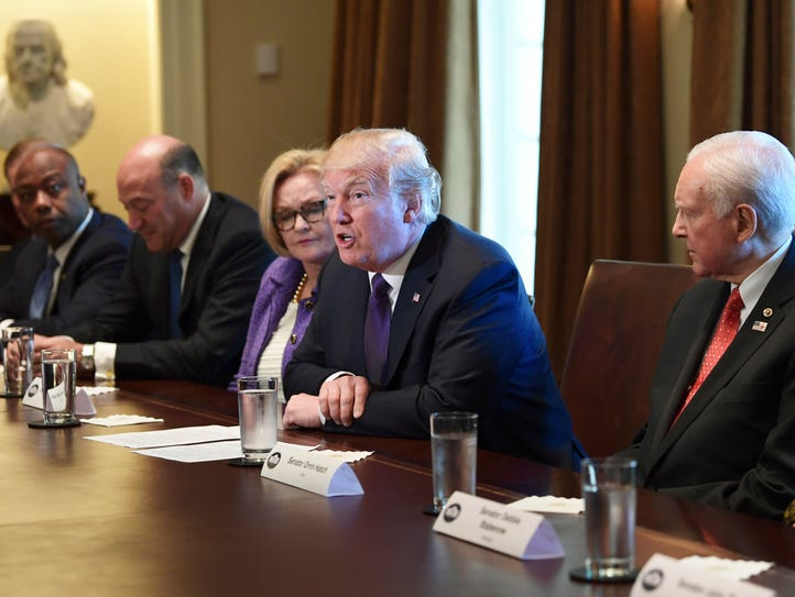 President Donald Trump, center, speaks during a meeting