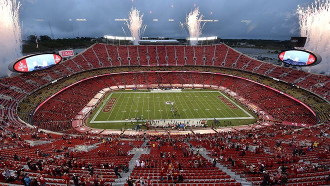 Fans were required to observe social distancing during the Kansas City Chiefs' season opener against the Houston Texans on Sept. 10 at Arrowhead Stadium in Kansas City, Missouri. Sunday's scheduled game against the Patriots at Arrowhead has been postponed to Monday or Tuesday because positive COVID tests.