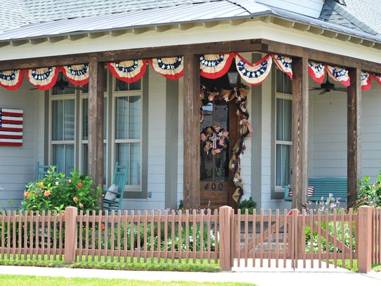 Patriotic flas and colors decorate a home in Sugar
