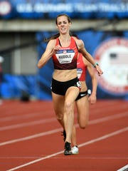 Molly Huddle wins the women's 5,000 meters in 15:05.01