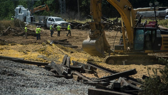 Crews clean up after a train derailed south of Alabama Street in Princeton on Tuesday, June 19, 2018.