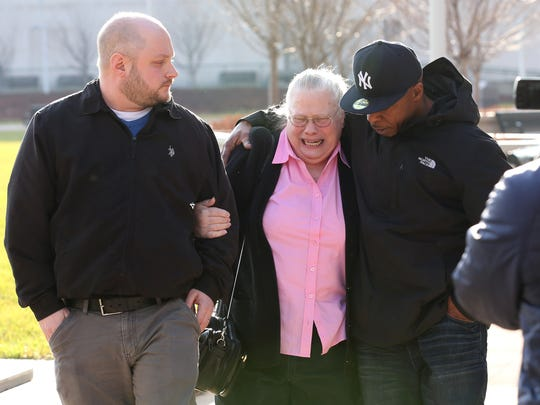 A woman who identified herself in court as the grandmother and legal guardian of Samantha Hughes leaves Rochester City Court after Hughes and five others were arraigned in connection to the kidnapping of two University of Rochester students.