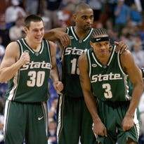 Chris Hill, second from right, hugs MSU coach Tom Izzo as Drew Neitzel cheers following the Spartans' double-overtime win over Kentucky on March 27, 2005. The win advanced MSU to the 2005 Final Four in St. Louis.
