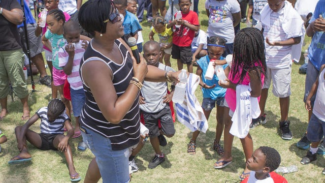 "City councilwoman Felicia Solomon speaks to the attendees of the ""For the Love of Kinston"" Peace Rally on Sunday at South East Elementary. Photo by Tyler Rose / The Free Press"