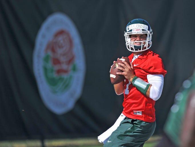 MSU Spartan quarterback Tyler O'Connor drops back for