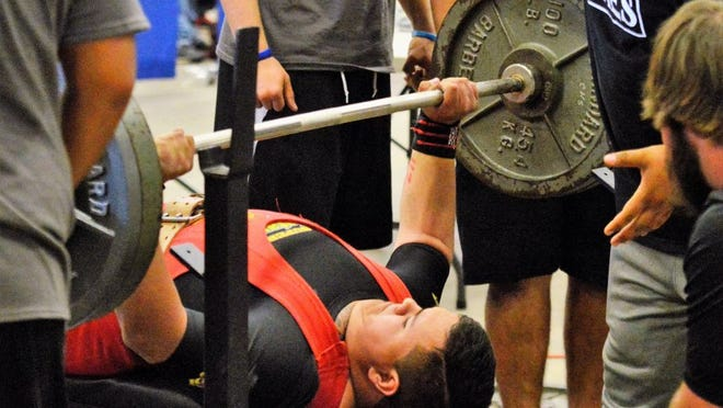 Clyde's Haddan Stokes pushes 400 pounds in the Division III 242-pound bench press competition of the Texas High School Powerlifting Association state meet on Saturday, April 2, 2016, at the Taylor County Expo Center.