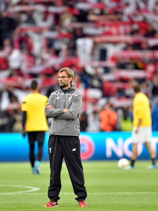 Liverpool manager Juergen Klopp stands on the pitch before the Europa League final soccer match between Liverpool and Sevilla in Basel, Switzerland, Wednesday, May 18, 2016. (AP Photo/Martin Meissner)