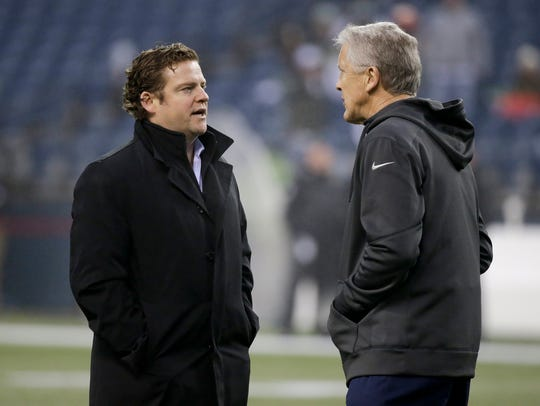 Seattle Seahawks general manager John Schneider, left,
