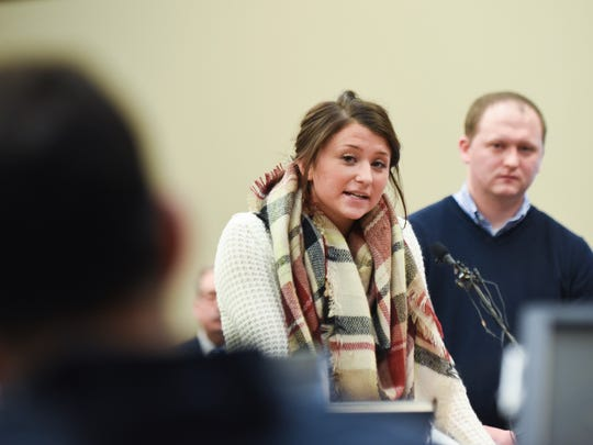 Lindsey Lemke addresses Larry Nassar on Thursday, Jan. 18, 2018, in Circuit Judge Rosemarie Aquilina's courtroom during the third day of victim impact statements in his sentencing hearing. In a powerful rebuke, she also addressed MSU President Lou Anna Simon, USA Gymnastics and John Geddert of Twistars.  Behind her is her brother.