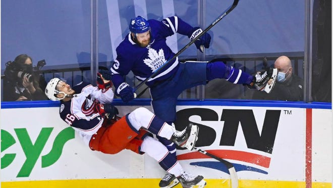 Leafs left wing Kyle Clifford (73) sent an early message with this big hit against Blue Jackets defenseman Dean Kukan (46) in the first period of Toronto's 3-0 victory Tuesday at Scotiabank Arena in Toronto.