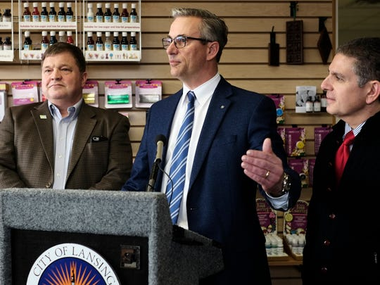 CEO of LorAnn Oils Inc, John Grettenberger Jr. talks about the expansion of his company as Lansing Mayor Virg Bernero, right, and Karl Dorshimer, director of business development for LEAP look on Friday, February 3, 2017.