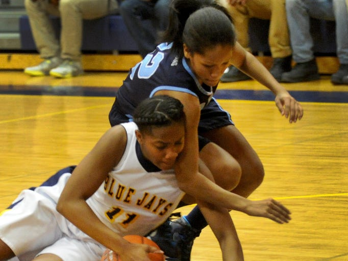 Seaford's Jade Purnell and Kori Johnson of Lake Forest go to the floor to battle for a loose ball in first half of Tuesday night's DIAA Girls Basketball State Tournament opening round game. Lake defeated Seaford 54-51.