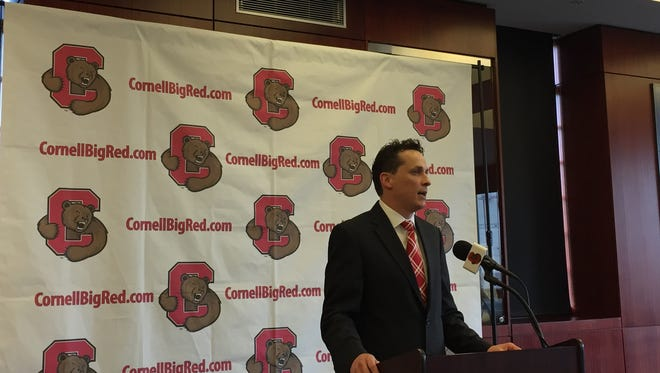 Brian Earl speaks during a press conference introducing him as Cornell University 22nd men's  basketball coach on Thursday in the Hall of Fame Room at Schoellkopf Memorial Hall.