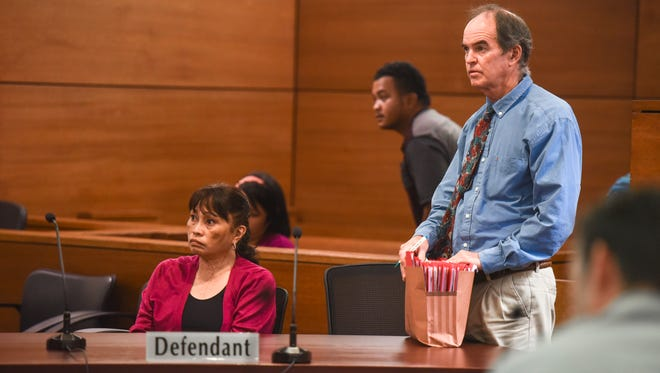 Defendant Frances Quinata, seated, appears with her attorney William Bischoff before Superior Court of Guam Judge Michael Bordallo at the Guam Judicial Center in Hagåtña on Thursday, Jan. 19, 2017.