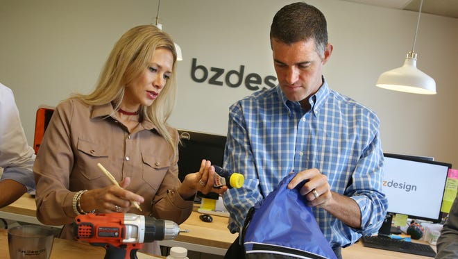 Untapped Shores executive director Elizabeth Shores, left, and husband and company CEO Patrick Shores, assemble the Untapped Shores handheld clear water device that will be shipped overseas, into small bagged units, at BZ Design in Henrietta Tuesday, Aug. 8, 2017.