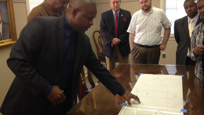 Columbus Cook, an Atlanta-based architect and a native to Wetumpka, shows renderings of potential improvements to the Black History Museum in Wetumpka on July 20.