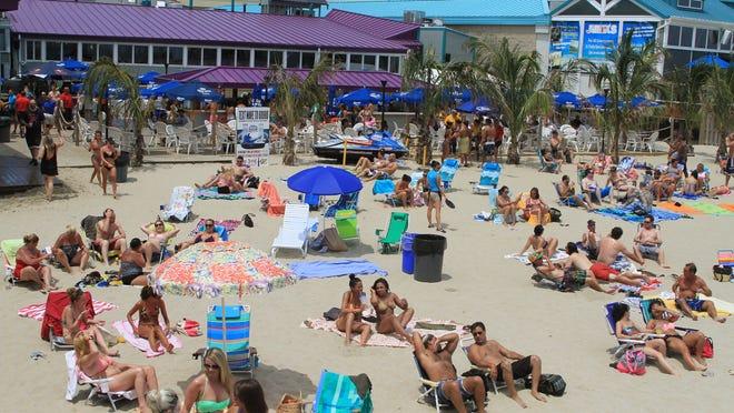 Beachgoers soak up the sun in Point Pleasant Beach in July 2013.
