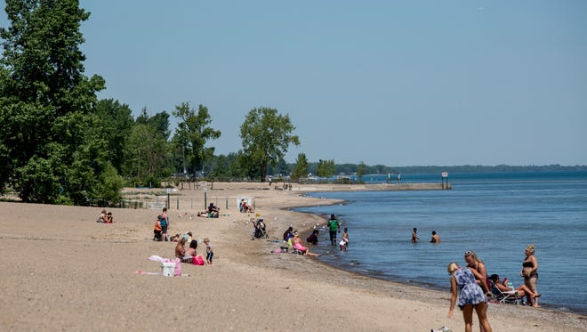 People enjoy the beach and lake Thursday, June 2, 2016 at Lakeside Park in Port Huron. The city is looking at ways to handle increasing crowds after nearly 7,000 people filled the park on Memorial Day.