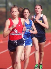 St. Henry junior Malia Heck leads a pack during the