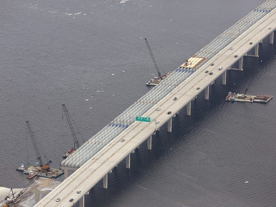 Contractors recondition the Roland Kampo Memorial Bridge