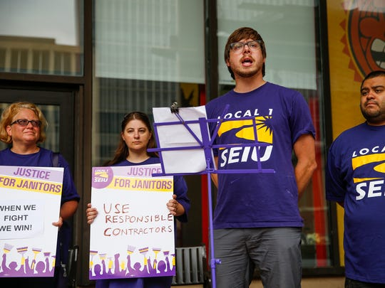 """Paul Nappier, local organizer with SEIU Local 1, speaks to a small crowd gathered during a celebration rally at City Market on Thursday, July 13, 2017. SEUI, other local union members and janitors were celebrating that the Gold Building owner decided to switch janitorial contractors to a more """"responsible"""" company that they say respected workers' rights to collective bargaining."""