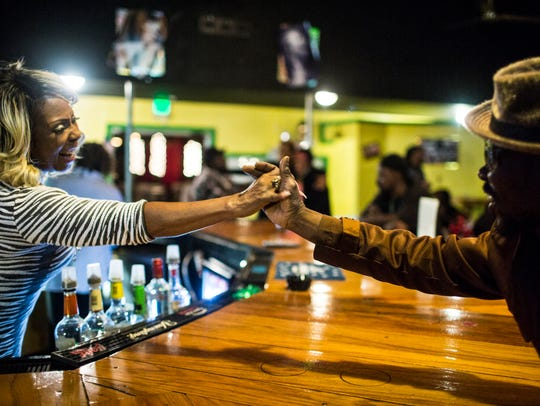 November 18, 2017 - Toni Green, left, welcomes Oscar Wright to her new establishment, Toni Green's Palace, that is a new bar and music venue at 4212 North Thomas.