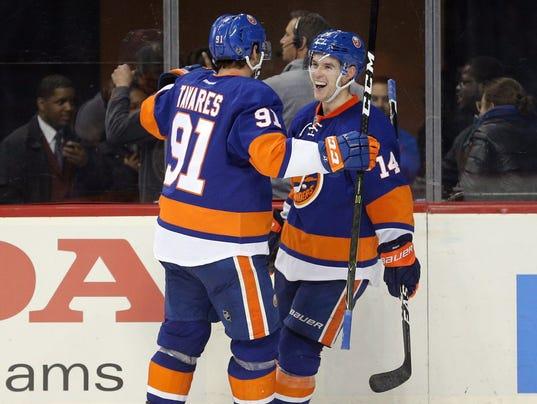 USP NHL: CALGARY FLAMES AT NEW YORK ISLANDERS S HKN USA NY