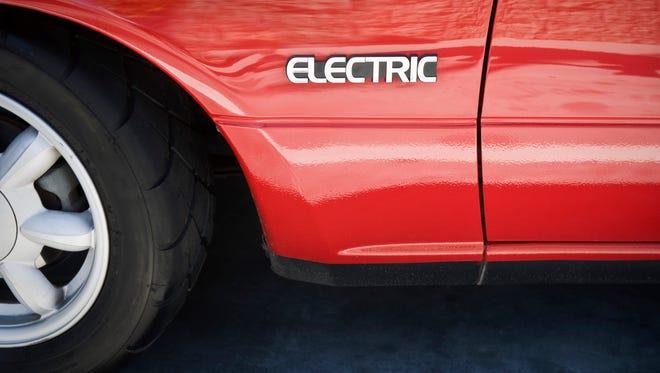 Closeup of sign on electric car.
