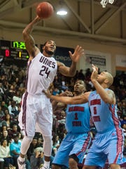 UMES forward Michael Myers takes a shot against Delaware