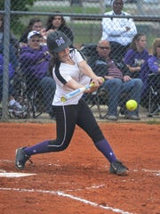 Milan's Gracie Kyle takes a swing during Tuesday's game against Scotts Hill.