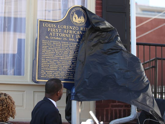 A historical marker is unveiled outside of Louis L.