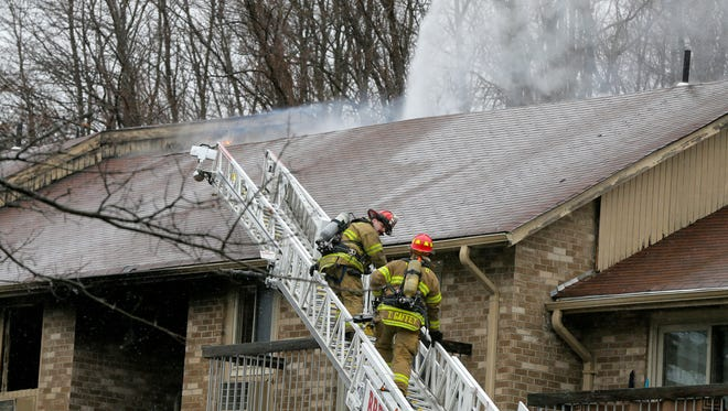 Firefighters battle a blaze at 270 Thousand Oaks Drive in Middletown Twp., NJ Friday March 2, 2018.