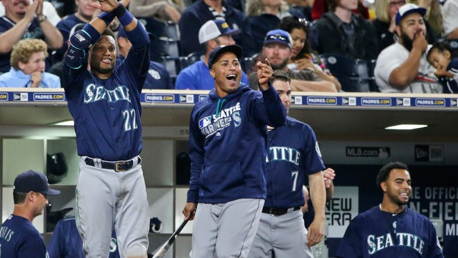 Seattle Mariners' Robinson Cano, Leonys Martin, Seth Smith, and Nelson Cruz, from left,  celebrate during the seventh inning against the San Diego Padres in a baseball game Thursday, June 2, 2016, in San Diego. The Mariners scored nine runs in the inning. (AP Photo/Lenny Ignelzi)