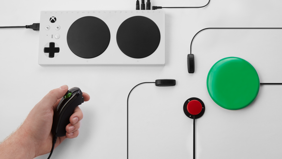 The Xbox Adaptive Controller with various accessories