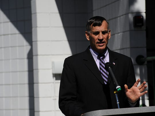 """Mike Kazmierski, President and CEO of EDAWN, talks about the winners of the """"Design a Taxi Top"""" contest during the unveiling ceremony at the Washoe County School District headquarters in Reno on April 29, 2015."""