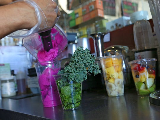 A Pitaya smoothie is scooped into a glass after being freshly prepared at Sip Coffee House and Juice Bar in Indio, Monday, November 2, 2015.