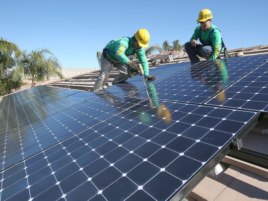 Potere Solar technicians Benny Lopez, left, and Anthony Cataudella install panels at a Rancho Mirage home on Jan. 26, 2016.