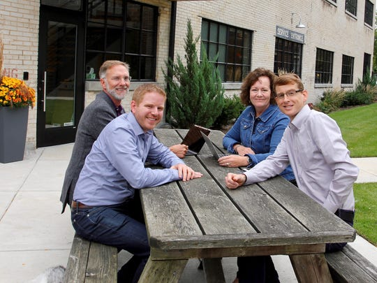From left at Atomic Object's Grand Rapids office: CEO and co-founder Carl Erickson, managing partner & Vice President Mike Marsiglia, business manager Mary O'Neill and managing partner & Vice President Shawn Crowley.