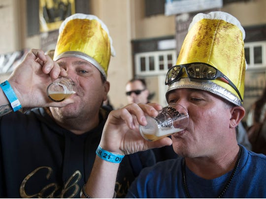 Frank Nebus and Joe Guzman, both of Old Bridge, enjoy beer as the Asbury Park Beerfest gets underway at Convention Hall on the boardwalk on Jan. 27.