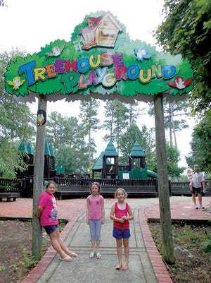Children visiting the Treehouse Playground in Bowie Nature Park are greeted by a new entrance sign.