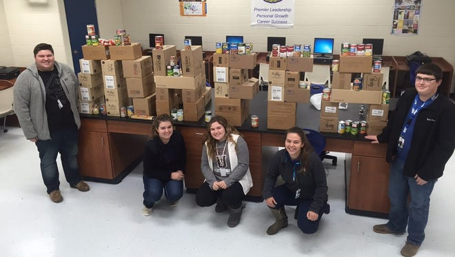 Students from the Mountain Home Future Farmers of America chapter, with the help of D&T Bargains, collected and donated over 1,000 items to the Foodbank of North Central Arkansas. D&T Bargans made the donation in loving memory of their its owner, Sean Patrick McKeough. Future Farmers of America members pictured are: (from left) Jakob Penka, Mackenzie Morrison, Taylor Richey, Mikala Brotherton and Wyatt Petty.