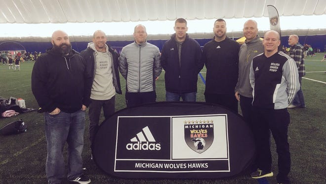 Posing under the Schoolcraft College soccer dome following the merger are (from left): Chris Burnette (Livonia City Soccer Club , President), Doug Landefeld (Michigan Hawks, Vice President and Director of Coaching), Rick Larson (Livonia City Soccer Club, Director of Coaching), Dan Mellors (Livonia City Soccer Club, Youth Director), Ken Shingledecker (Livonia City Soccer Club, Director of Operations), Lars Richters (Michigan Wolves, Academy Director), Ed McCarthy (Michigan Wolves-Hawks, President).