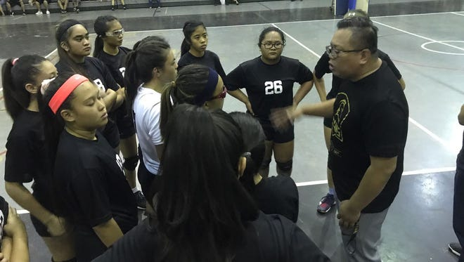 Inside a Titans huddle on Friday night at the Simon Sanchez Gym in Dededo.